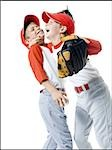 Close-up of two baseball players smiling Stock Photo - Premium Royalty-Free, Artist: Jerzyworks, Code: 640-02766638