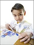 Portrait of a boy painting with a paintbrush Stock Photo - Premium Royalty-Free, Artist: Visuals Unlimited, Code: 640-02766781