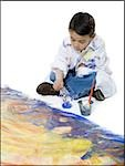 High angle view of a boy painting on the floor Stock Photo - Premium Royalty-Free, Artist: Jerzyworks, Code: 640-02766793