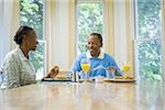 Senior man and a senior woman having breakfast Stock Photo - Premium Royalty-Freenull, Code: 640-02766891