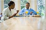 Senior man and a senior woman having breakfast Stock Photo - Premium Royalty-Freenull, Code: 640-02766892