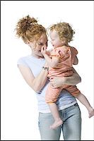 female rear end - Close-up of a young woman holding her daughter Stock Photo - Premium Royalty-Freenull, Code: 640-02766937