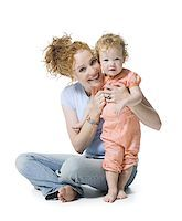 Portrait of a young woman and her daughter smiling Stock Photo - Premium Royalty-Freenull, Code: 640-02766938