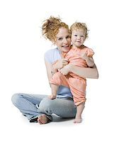 Portrait of a young woman and her daughter smiling Stock Photo - Premium Royalty-Freenull, Code: 640-02766939