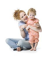 Portrait of a young woman and her daughter smiling Stock Photo - Premium Royalty-Freenull, Code: 640-02766940
