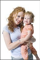 Portrait of a young woman hugging her daughter Stock Photo - Premium Royalty-Freenull, Code: 640-02766941