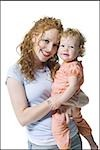 Portrait of a young woman hugging her daughter Stock Photo - Premium Royalty-Free, Artist: Westend61, Code: 640-02766941