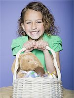 preteen thong - Portrait of a girl holding Easter eggs in a wicker basket Stock Photo - Premium Royalty-Freenull, Code: 640-02766975