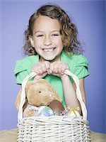 preteen thong - Portrait of a girl holding Easter eggs in a wicker basket Stock Photo - Premium Royalty-Freenull, Code: 640-02766976