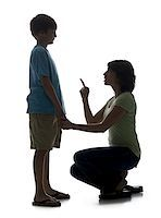 Close-up of a mid adult woman scolding her son Stock Photo - Premium Royalty-Freenull, Code: 640-02766985