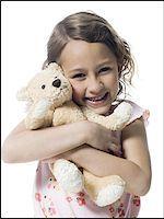 preteen kissing - Portrait of a girl hugging a teddy bear Stock Photo - Premium Royalty-Freenull, Code: 640-02766995