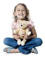 preteen kissing - Portrait of a girl hugging a teddy bear Stock Photo - Premium Royalty-Freenull, Code: 640-02766997