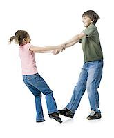 preteen thong - Close-up of a boy playing with his sister Stock Photo - Premium Royalty-Freenull, Code: 640-02767000