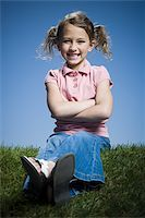 preteen thong - Portrait of a girl sitting with her arms crossed Stock Photo - Premium Royalty-Freenull, Code: 640-02767004