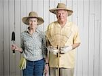 Portrait of an elderly couple standing with gardening tools Stock Photo - Premium Royalty-Freenull, Code: 640-02767042