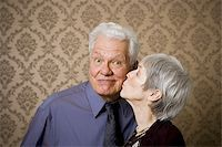 Close-up of an elderly woman kissing an elderly man Stock Photo - Premium Royalty-Freenull, Code: 640-02767066