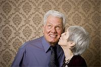 Close-up of an elderly woman kissing an elderly man Stock Photo - Premium Royalty-Freenull, Code: 640-02767067