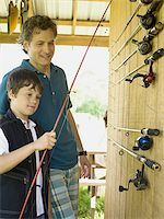Boy and a man standing in a store Stock Photo - Premium Royalty-Freenull, Code: 640-02767078
