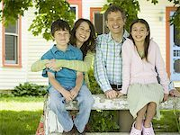 Portrait of a man and a woman smiling with their children Stock Photo - Premium Royalty-Freenull, Code: 640-02767194