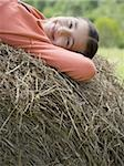 Portrait of a girl lying on a hay bale Stock Photo - Premium Royalty-Free, Artist: Eyecandy Pro, Code: 640-02767228