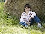 Portrait of a boy sitting against a hay bale Stock Photo - Premium Royalty-Free, Artist: Eyecandy Pro, Code: 640-02767229