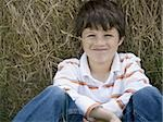 Portrait of a boy sitting against a hay bale Stock Photo - Premium Royalty-Free, Artist: Eyecandy Pro, Code: 640-02767234
