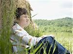 Portrait of a boy sitting against a hay bale Stock Photo - Premium Royalty-Free, Artist: Robert Harding Images, Code: 640-02767235