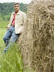 Portrait of a man leaning against a hay bale Stock Photo - Premium Royalty-Free, Artist: Eyecandy Pro, Code: 640-02767564