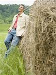 Portrait of a man leaning against a hay bale Stock Photo - Premium Royalty-Free, Artist: Eyecandy Pro, Code: 640-02767565
