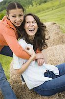 Portrait of a girl hugging her mother from behind Stock Photo - Premium Royalty-Freenull, Code: 640-02767570