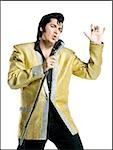 Close-up of an Elvis impersonator singing into a microphone Stock Photo - Premium Royalty-Free, Artist: Jerzyworks, Code: 640-02767591