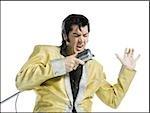 An Elvis impersonator singing into a microphone Stock Photo - Premium Royalty-Free, Artist: Jerzyworks, Code: 640-02767597