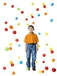 Boy playing with colored balls Stock Photo - Premium Royalty-Free, Artist: Eyecandy Pro, Code: 640-02767699