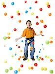 Boy playing with colored balls Stock Photo - Premium Royalty-Free, Artist: Flowerphotos, Code: 640-02767700