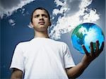 Portrait of a teenage boy holding a globe Stock Photo - Premium Royalty-Free, Artist: imagebroker, Code: 640-02767756