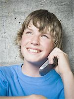 Portrait of a teenage boy using a mobile phone Stock Photo - Premium Royalty-Freenull, Code: 640-02767762