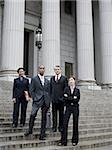 Low angle view of lawyers standing on the steps of a courthouse Stock Photo - Premium Royalty-Free, Artist: Arcaid, Code: 640-02767787