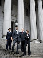 Low angle view of lawyers standing on the steps of a courthouse Stock Photo - Premium Royalty-Freenull, Code: 640-02767789