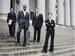 Low angle view of lawyers standing on the steps of a courthouse Stock Photo - Premium Royalty-Free, Artist: Arcaid, Code: 640-02767790
