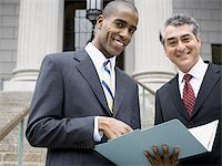 Low angle view of two lawyers smiling Stock Photo - Premium Royalty-Freenull, Code: 640-02767797