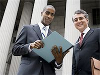 Low angle view of two lawyers smiling Stock Photo - Premium Royalty-Freenull, Code: 640-02767799