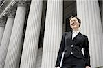 Low angle view of a female lawyer standing in front of a courthouse Stock Photo - Premium Royalty-Free, Artist: Arcaid, Code: 640-02767810