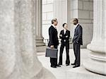 Three lawyers talking in front of a courthouse Stock Photo - Premium Royalty-Free, Artist: Arcaid, Code: 640-02767822