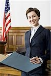 Portrait of a female lawyer standing in a courtroom Stock Photo - Premium Royalty-Freenull, Code: 640-02767841