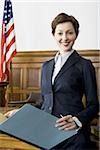 Portrait of a female lawyer standing in a courtroom Stock Photo - Premium Royalty-Freenull, Code: 640-02767842