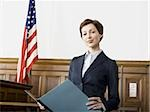 Portrait of a female lawyer standing in a courtroom and smiling Stock Photo - Premium Royalty-Freenull, Code: 640-02767843