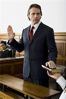 Witness swearing over the Bible Stock Photo - Premium Royalty-Freenull, Code: 640-02767855