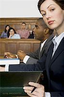 Portrait of a female lawyer sitting in a courtroom Stock Photo - Premium Royalty-Freenull, Code: 640-02767863