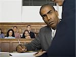 A male lawyer looking at another lawyer in a courtroom Stock Photo - Premium Royalty-Freenull, Code: 640-02767865