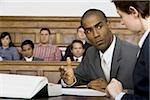 A male lawyer looking at another lawyer in a courtroom Stock Photo - Premium Royalty-Free, Artist: Aflo Relax, Code: 640-02767867